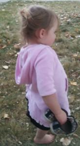 girl in fall leaves