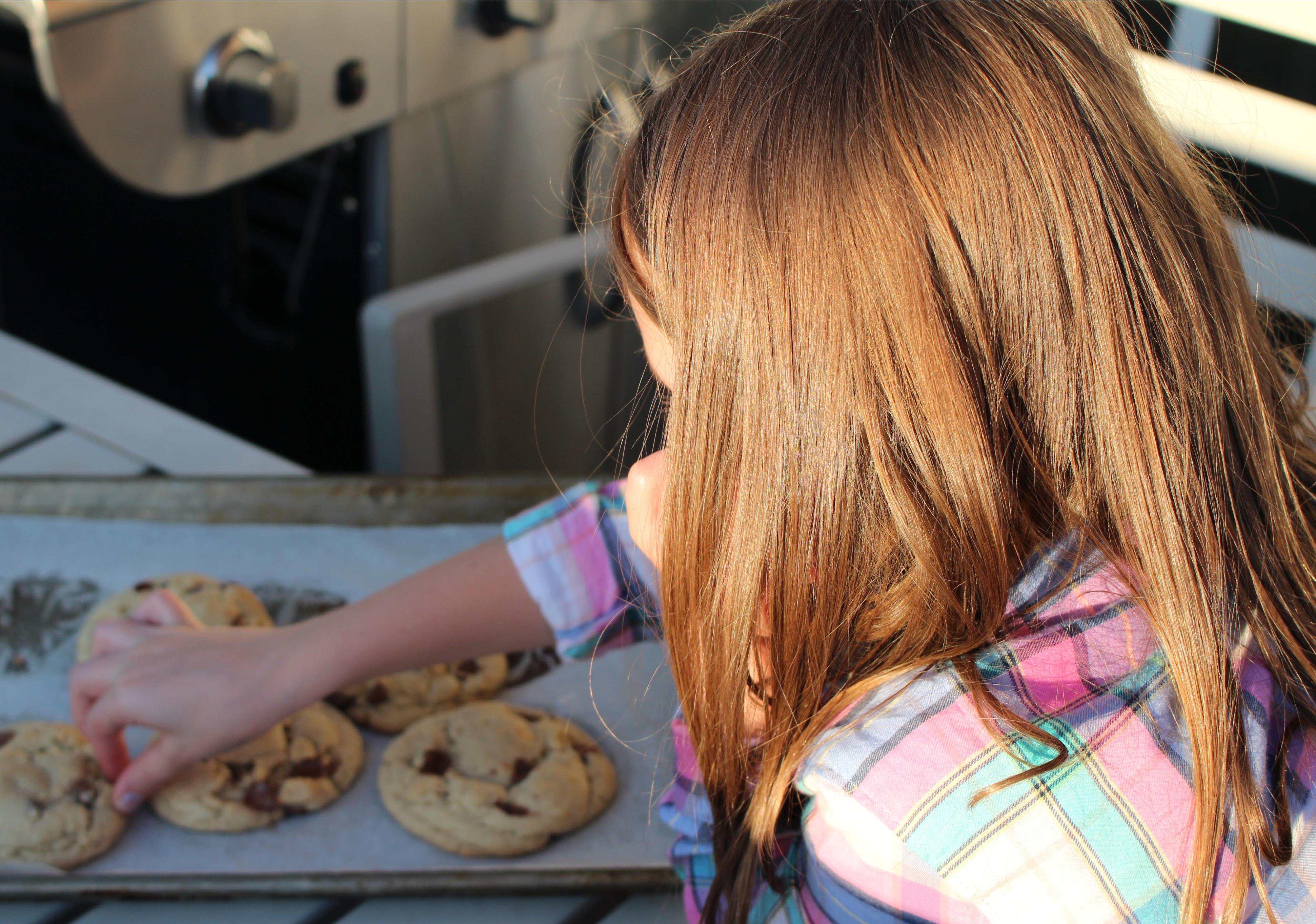 girl helps make cookies